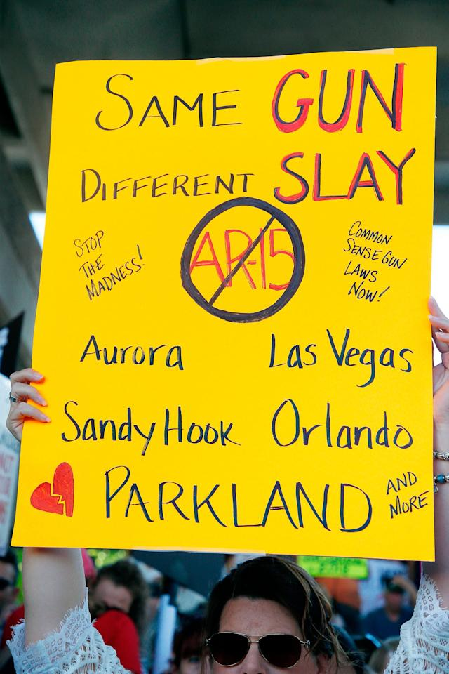 <p>Protesters hold signs at a rally for gun control at the Broward County Federal Courthouse in Fort Lauderdale, Florida on Feb. 17, 2018. (Photo: Rhona Wise/AFP/Getty Images) </p>