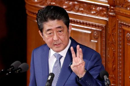 FILE PHOTO: Japan's Prime Minister Shinzo Abe makes a speech at an opening of a new session of parliament in Tokyo
