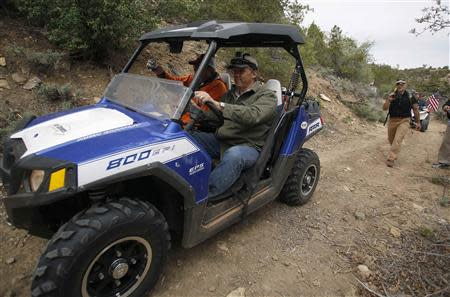 Phil Lyman, a San Juan County commissioner, drives in Recapture Canyon outside Blanding, Utah