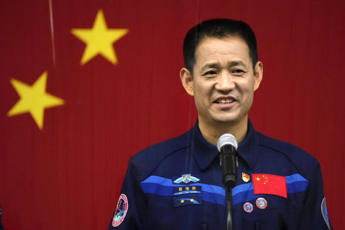 Chinese astronaut Nie Haisheng speaks during a press conference at the Jiuquan Satellite Launch Center ahead of the Shenzhou-12 launch from Jiuquan in northwestern China, Wednesday, June 16, 2021. China plans on Thursday to launch three astronauts onboard the Shenzhou-12 spaceship, who will be the first crew members to live on China's new orbiting space station Tianhe, or Heavenly Harmony from the Jiuquan Satellite Launch Center in northwest China. (AP Photo/Ng Han Guan)