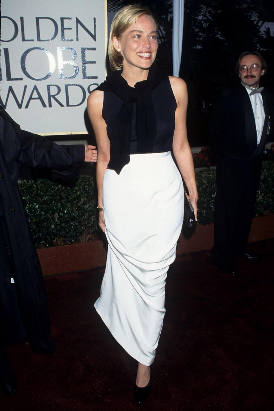 """<strong><h2>1996</h2></strong><br>It's official: Sharon Stone strutting onto the red carpet in this Vera Wang black and white ensemble (sweater around the shoulders included!) is 2019 #stylegoals.<br><br><em>Sharon Stone in Vera Wang.</em><span class=""""copyright"""">Photo: Ke.Mazur/WireImage.</span>"""