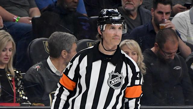 Referee Wes McCauley suffered a leg injury about eight minutes into the contest when he appeared to trip over the skate of a fellow referee.