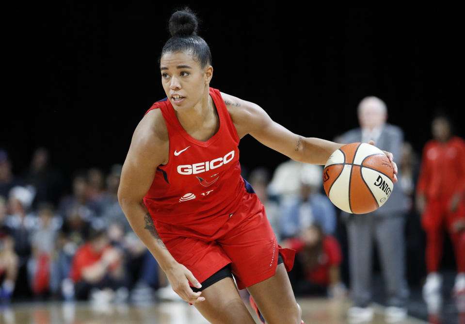 FILE - In this Sept. 24, 2019 file photo, Washington Mystics' Natasha Cloud drives up the court against the Las Vegas Aces during the second half of Game 4 of a WNBA playoff basketball in Las Vegas. Cloud and her WNBA colleagues continue to be active in the fight against social injustice and police brutality, participating in protests and continuing work that they began four years ago. (AP Photo/John Locher, File)