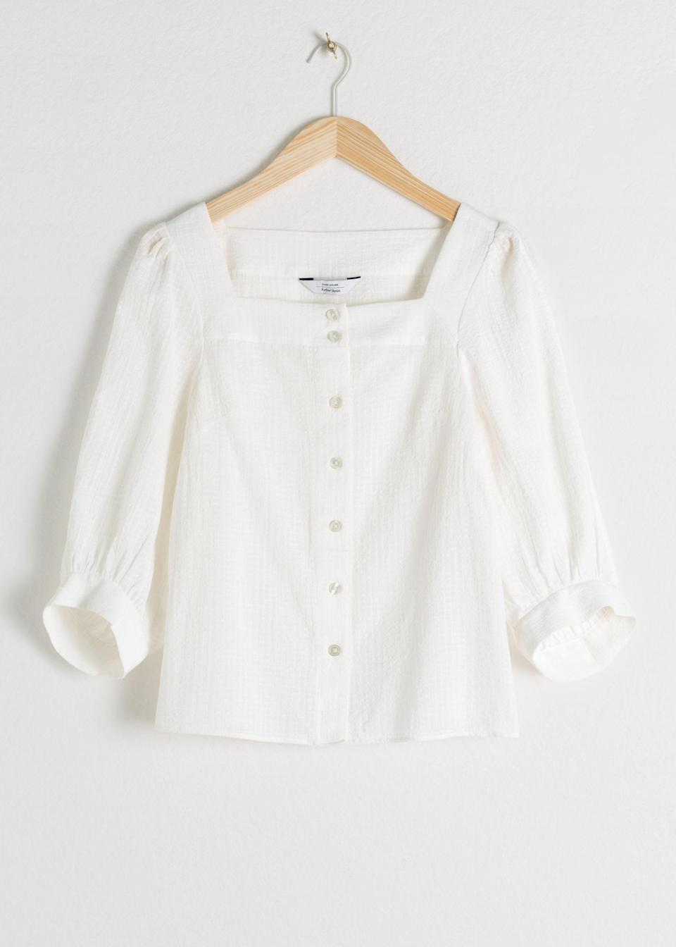 """$69, & Other Stories. <a href=""""https://www.stories.com/en_usd/clothing/blouses-shirts/blouses/product.plaid-puff-sleeve-blouse-white.0727763002.html"""" rel=""""nofollow noopener"""" target=""""_blank"""" data-ylk=""""slk:Get it now!"""" class=""""link rapid-noclick-resp"""">Get it now!</a>"""