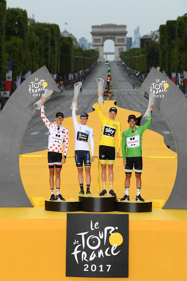 Cycling - The 104th Tour de France cycling race - The 103-km Stage 21 from Montgeron to Paris Champs-Elysees, France - July 23, 2017 - Team Sunweb rider and polka-dot jersey Warren Barguil of France, Orica-Scott rider and white jersey Simon Yates of Britain, Team Sky rider and yellow jersey Chris Froome of Britain and Team Sunweb rider and green jersey Michael Matthews of Australia on the podium.  REUTERS/Franck Faugere/Pool