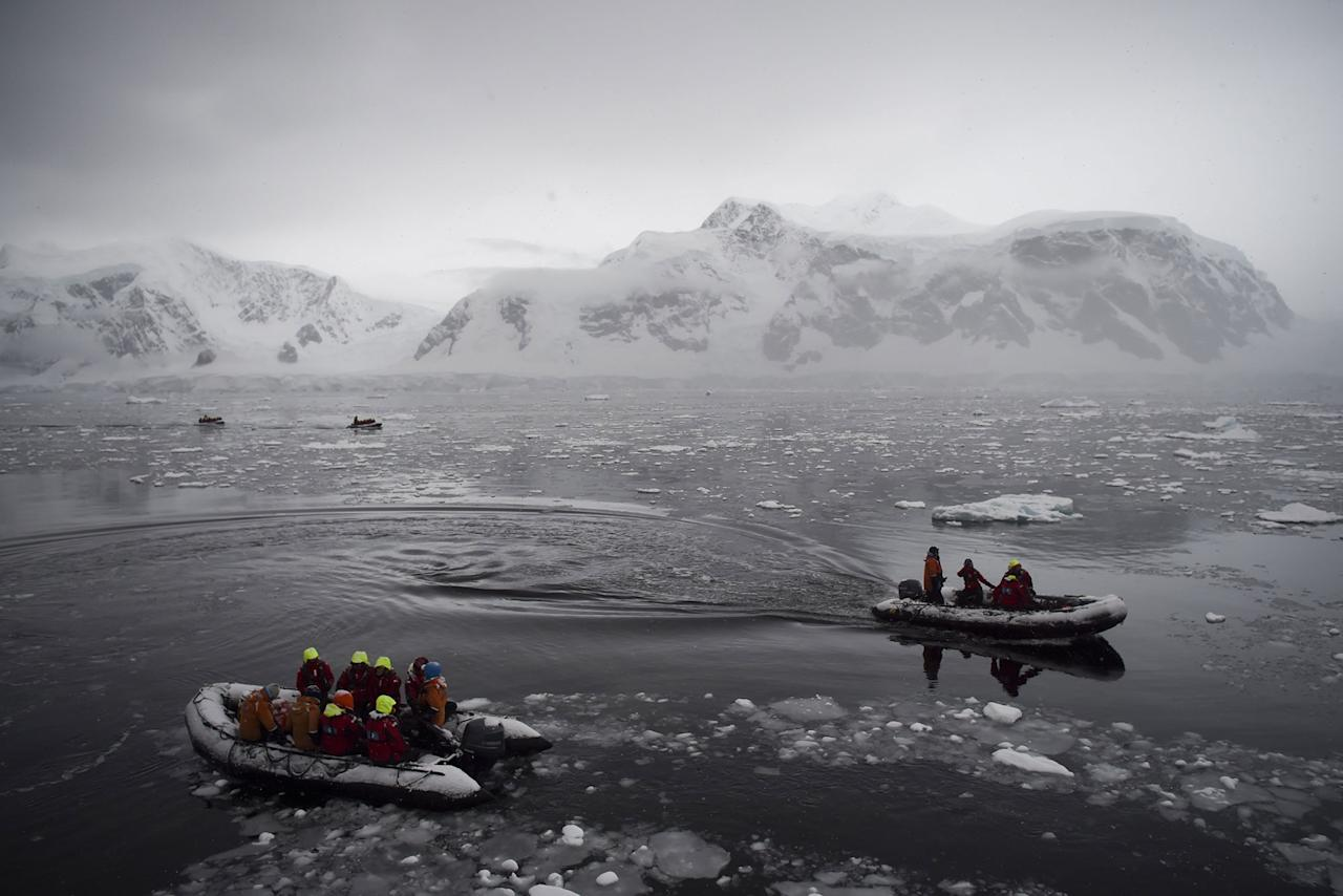 <p>Tourists cruise the western Antarctic peninsula on March 5, 2016. The Antarctic tourism industry is generally considered to have begun in the late 1950s when Chile and Argentina took more than 500 fare-paying passengers to the South Shetland Islands aboard a naval transportation ship. The concept of 'expedition cruising,' coupled with education as a major theme, began when Lars-Eric Lindblad led the first traveler's expedition to Antarctica in 1966. Prior to this, human activity in Antarctica was limited to the early explorers, those seeking fortune in the exploitation of seals and whales, and more recently to scientific research and exploration. (Photo: Eitan Abramovich/AFP/Getty Images) </p>
