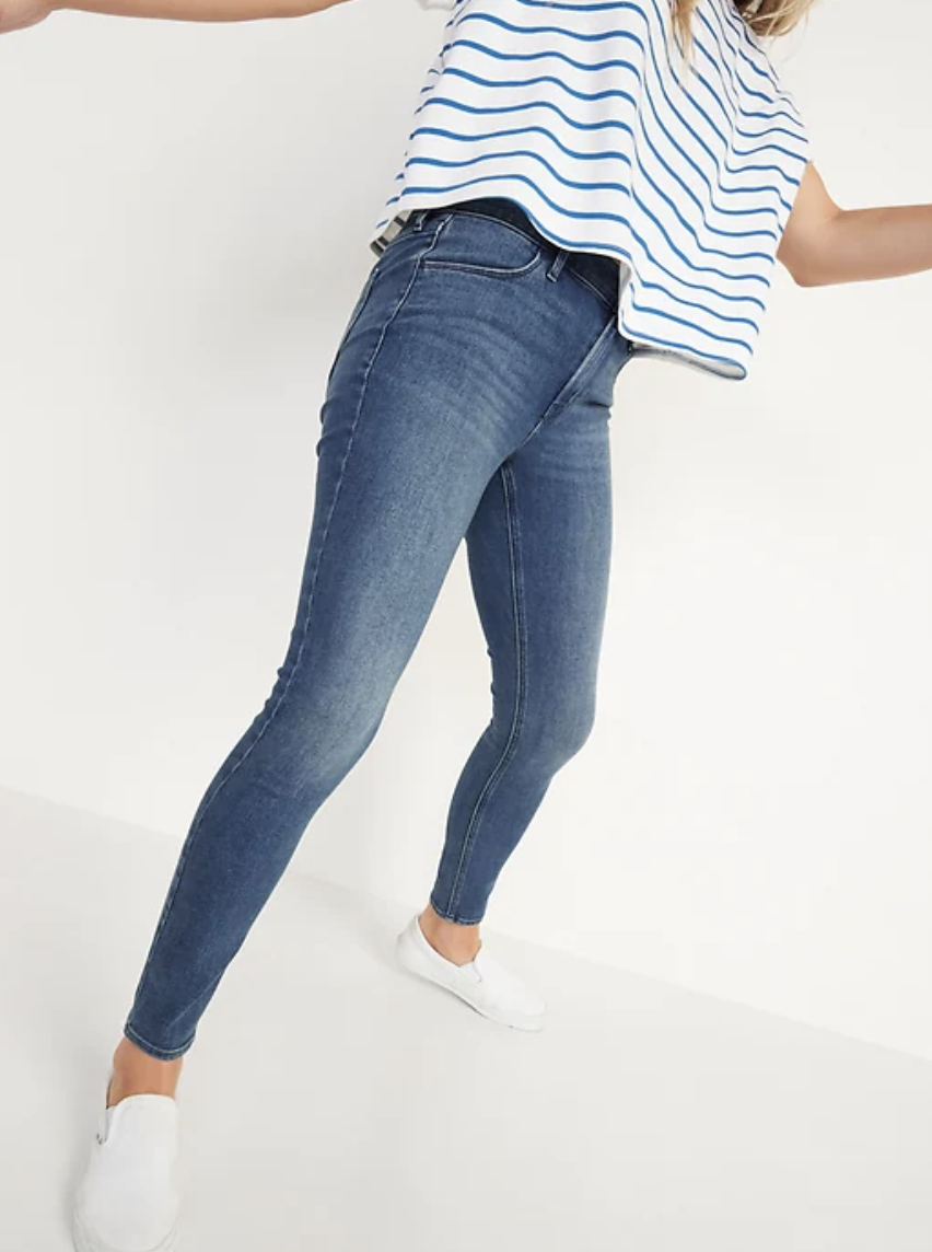 woman in blue Mid-Rise Medium-Wash Super Skinny Jeans and white and blue striped t-shirt