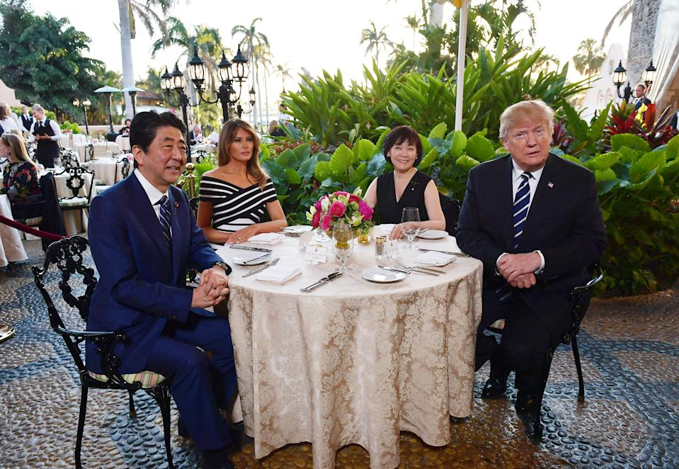 President Trump and first lady Melania Trump are seated for dinner with Japanese Prime Minister Shinzo Abe and his wife, Akie Abe, at Trump's Mar-a-Lago resort in Palm Beach, Fla., April 17, 2018. (Photo by Mandel NganGAN/AFP via Getty Images)