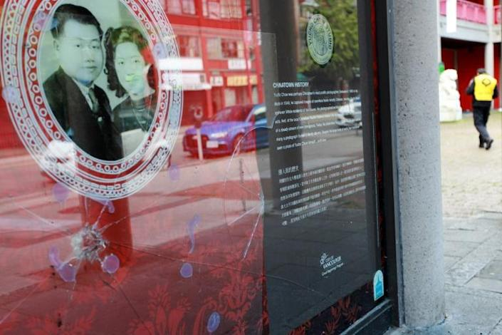 A broken window at Vancouver's Chinese Cultural Centre, pictured in May, 2020 is just one of the acts of vandalism and racist taunts that have targeted Chinese-Canadians since the start of the coronavirus pandemic (AFP Photo/David P. BALL)