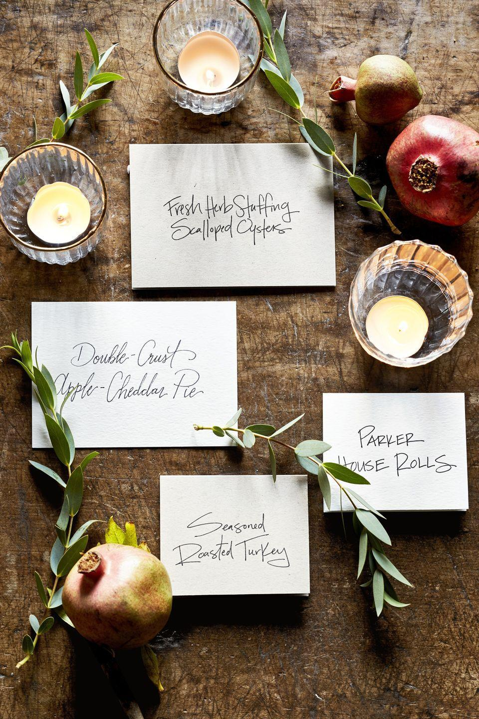 """<p>Show off your calligraphy skills alongside your cooking skills. Menu cards are not only functional, but can be a beautiful addition to your Thanksgiving dinner, too. </p><p><a class=""""link rapid-noclick-resp"""" href=""""https://www.amazon.com/White-Thick-Paper-Cardstock-Invitations/dp/B00RU6IGAS/?tag=syn-yahoo-20&ascsubtag=%5Bartid%7C10050.g.1371%5Bsrc%7Cyahoo-us"""" rel=""""nofollow noopener"""" target=""""_blank"""" data-ylk=""""slk:SHOP WHITE CARD STOCK"""">SHOP WHITE CARD STOCK</a></p>"""