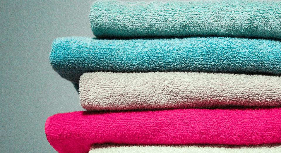 Experts claim you should be washing your kitchen towels every day and your bath towels every three days. [Photo: Getty]