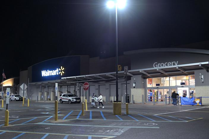 <p>Customers exit a 24 hour Walmart on Black Friday on 27 November 2020 in Neptune City, New Jersey</p> ((Getty Images))