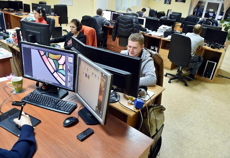 Frogwares programmers work at the video game company in Kiev on November 12, 2014 (AFP Photo/Sergei Supinsky)