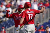 Philadelphia Phillies' Bryce Harper, left, celebrates with teammate Rhys Hoskins after hitting a solo home run in the third inning of a baseball game against the Washington Nationals, Thursday, Aug. 5, 2021, in Washington. (AP Photo/Patrick Semansky)