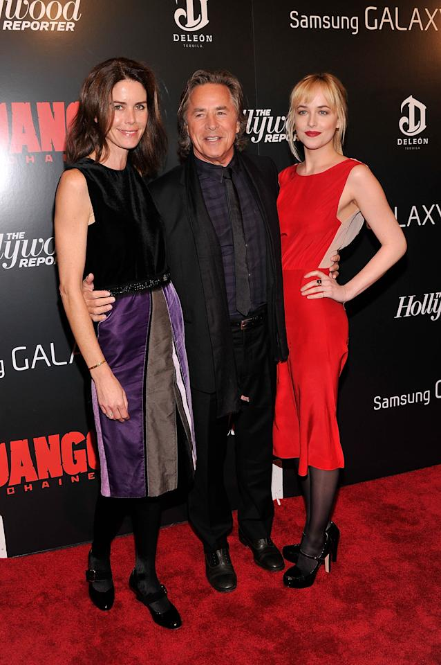 "NEW YORK, NY - DECEMBER 11:  Kelley Phleger, Don Johnson and Dakota Johnson attend a screening of ""Django Unchained"" hosted by The Weinstein Company with The Hollywood Reporter, Samsung Galaxy and The Cinema Society at Ziegfeld Theater on December 11, 2012 in New York City.  (Photo by Stephen Lovekin/Getty Images)"