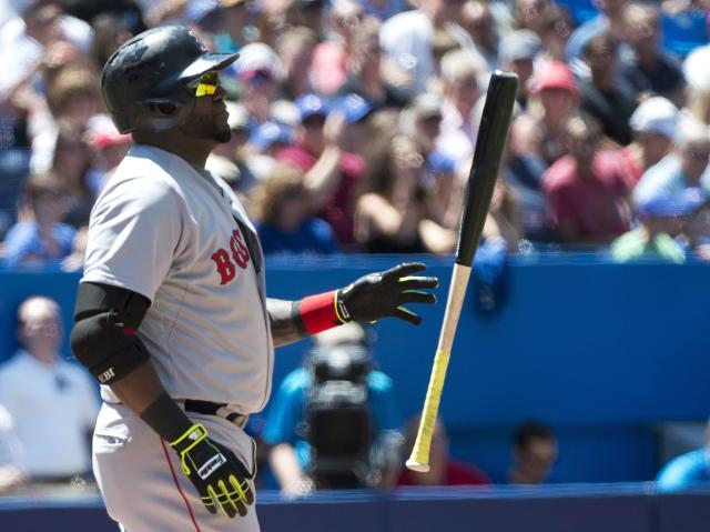 Boston Red Sox' designated hitter David Ortiz tosses his bat after striking out against Toronto Blue Jays starter Marcus Stroman during fourth inning baseball action in Toronto on Thursday, July 24, 2014. (AP Photo/The Canadian Press, Nathan Denette)