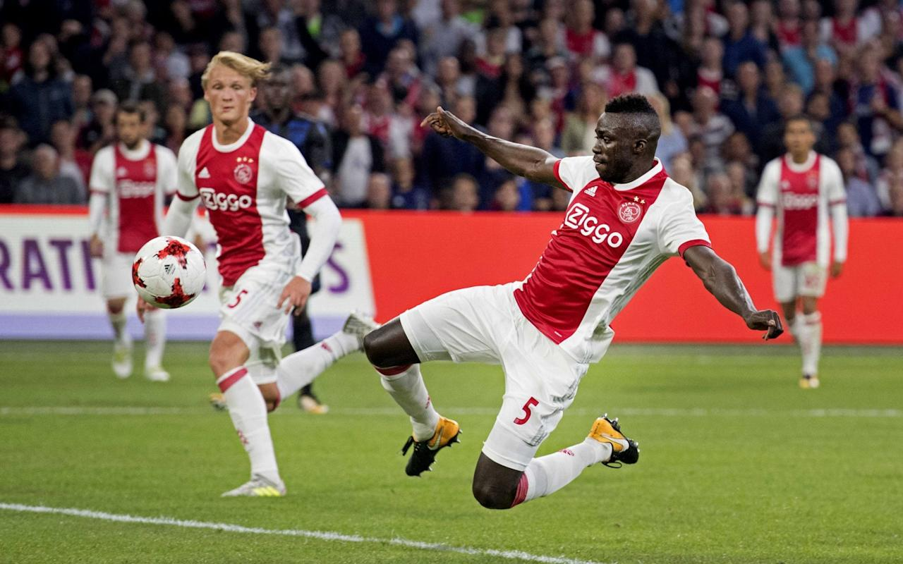Tottenham Hotspur are closing in on their first signing of the summer, despite a last-minute dispute over how quickly the fee for Ajax central defender Davinson Sanchez will be paid. Sanchez did not report to the Ajax team hotel for the Dutch club's Europa League play-off against Rosenborg on Thursday night, as Spurs attempted to finally secure his signature. Tottenham are willing to pay around £28million up front and a potential £14m in add-ons to take Sanchez to White Hart Lane. With the two clubs in broad agreement over the figures, it is believed that a final agreement is just waiting on how quickly the fee will be paid by Spurs with Ajax trying to bring it forwards. The dispute over the payment schedule is not expected to scupper the deal with Sanchez keen to complete a back three of former Ajax defenders at Spurs with Jan Vertonghen and Toby Alderweireld. Sanchez did not report to the Ajax team hotel ahead of their Europa League game on Thursday Credit: AFP It is understood that Tottenham manager Mauricio Pochettino has been personally pushing for the signature of Sanchez, having become convinced he is the perfect man to strengthen his back line. The 21-year-old Colombia international has previously been tracked by Barcelona and was a key part of Ajax's run to the Europa League final last season. Who should Spurs sign? Sanchez's expected arrival will allow Tottenham to offload Kevin Wimmer to West Bromwich Albion and will give Pochettino a big boost. He can operate at both centre-back and right-back, where Spurs are short following the departure of Kyle Walker, and it now remains to be seen whether or not the club continue to chase a specialist right-back to compete with Kieran Trippier. Pochettino wants at least three new players by the time the transfer window closes at the end of the month with midfielder Ross Barkley and a forward still on his radar. Pick your free Telegraph Fantasy Football team now and start scoring from the next kick-off >>