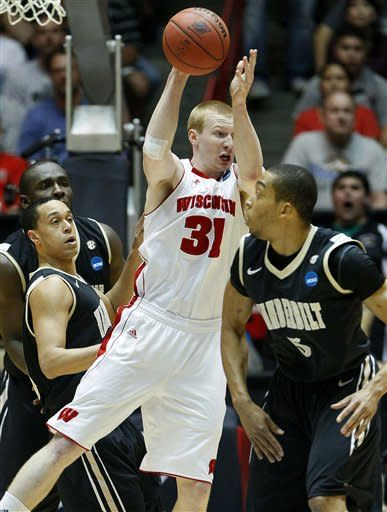 Wisconsin forward Mike Bruesewitz (31) looks to pass against Vanderbilt  during the first half of an NCAA tournament third-round college basketball game on Saturday, March 17, 2012, in Albuquerque, N.M. (AP Photo/Matt York)