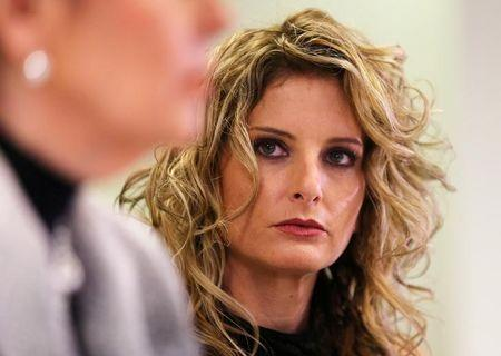 FILE PHOTO --  Summer Zervos listens as her attorney Gloria Allred speaks during a news conference announcing the filing of a lawsuit against President-elect Donald Trump in  Los Angeles, California