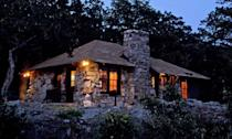 "<p><strong><a href=""https://www.yelp.com/biz/mt-nebo-state-park-dardanelle"" rel=""nofollow noopener"" target=""_blank"" data-ylk=""slk:Mt. Nebo State Park Cabin Rental"" class=""link rapid-noclick-resp"">Mt. Nebo State Park Cabin Rental</a> in Dardanelle </strong></p><p>""The cabin was AWESOME, especially for the price (being a state park it was pretty cheap compared to staying at like a private cabin). They bring you fresh linens every day, if you need something just ask. The kitchen had plenty of plates and cookware, oven, stove, full size fridge. There is a fireplace but they lock them during the summer. Out back we had our own grill & fire pit. Going on the trails was the best part. We went hiking for probably four hours and didn't run into a single person!"" - Yelp user <a href=""https://www.yelp.com/user_details?userid=8uvJ46i9x0SXi4vNAIgoeQ"" rel=""nofollow noopener"" target=""_blank"" data-ylk=""slk:Jason R."" class=""link rapid-noclick-resp"">Jason R.</a></p><p>Photo: <a href=""https://www.arkansasstateparks.com/parks/mount-nebo-state-park"" rel=""nofollow noopener"" target=""_blank"" data-ylk=""slk:Arkansas State Parks"" class=""link rapid-noclick-resp"">Arkansas State Parks</a></p>"