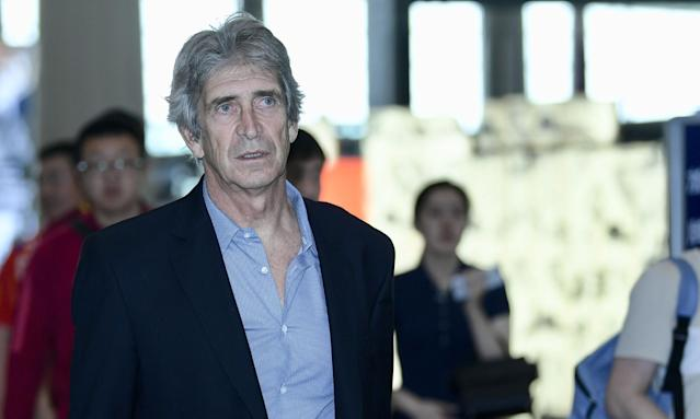 Manuel Pellegrini on his way from Beijing to London at the weekend ahead of discussing a deal to become West Ham United's new manager.