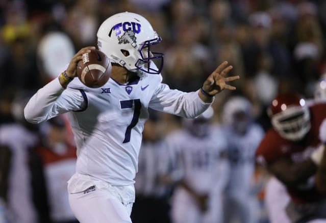 "TCU quarterback <a class=""link rapid-noclick-resp"" href=""/ncaaf/players/228307/"" data-ylk=""slk:Kenny Hill"">Kenny Hill</a> (7) passes in the first quarter of an NCAA college football game against Oklahoma in Norman, Okla., Saturday, Nov. 11, 2017. (AP Photo/Sue Ogrocki)"