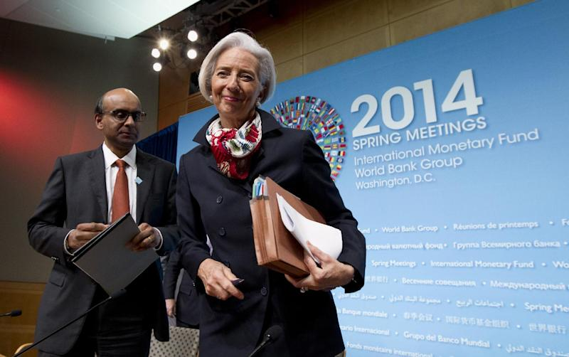 International Monetary Fund (IMF) Managing Director Christine Lagarde, right, followed by IMFC Chair and Singapore Finance Minister Tharman Shanmugaratnam, leaves after a news conference at World Bank Group-International Monetary Fund Spring Meetings in Washington, Saturday, April 12, 2014. ( AP Photo/Jose Luis Magana)