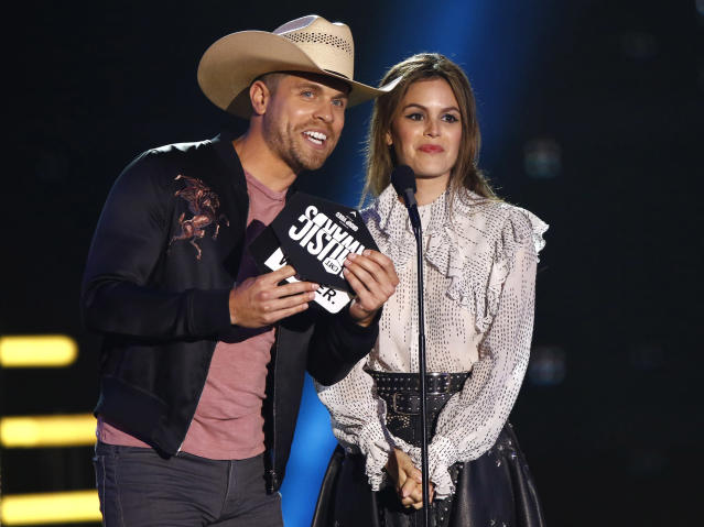 <p>Dustin Lynch and Rachel Bilson present the award for group video of the year at the CMT Music Awards at Music City Center on Wednesday, June 7, 2017, in Nashville, Tenn. (Photo by Wade Payne/Invision/AP) </p>
