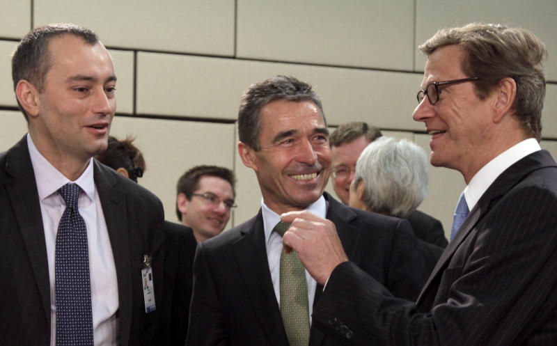 German Foreign Minister Guido Westerwelle, right, speaks with Bulgaria's Foreign Minister Nikolay Mladenov. left, and NATO Secretary General Anders Fogh Rasmussen during a meeting of the NATO-Russia Council at NATO headquarters in Brussels on Thursday, April 19, 2012.  Afghanistan was set to continue dominating a second day of ministerial talks at NATO on Thursday. Talks will also focus on the missile shield that the military alliance wants to deploy in Europe. (AP Photo/Virginia Mayo)