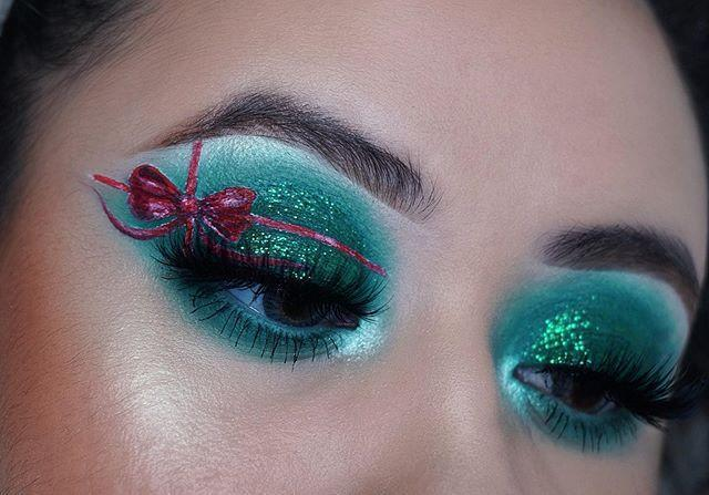 """<p>For this super cute eye art, choose one eye and fashion a bow (you pick the color, but red is our fave!) over glitter eyeshadow. One fun thing about this gift-wrap eye makeup idea is that you can customize it with any colors you like.</p><p><a class=""""link rapid-noclick-resp"""" href=""""https://www.amazon.com/NYX-PROFESSIONAL-MAKEUP-Vivid-Brights/dp/B01EMTAI7E/?tag=syn-yahoo-20&ascsubtag=%5Bartid%7C10050.g.34534998%5Bsrc%7Cyahoo-us"""" rel=""""nofollow noopener"""" target=""""_blank"""" data-ylk=""""slk:SHOP RED LIQUID EYELINER"""">SHOP RED LIQUID EYELINER</a></p><p><a href=""""https://www.instagram.com/p/B6BsJ7HJ0yn/?utm_source=ig_embed&utm_campaign=loading"""" rel=""""nofollow noopener"""" target=""""_blank"""" data-ylk=""""slk:See the original post on Instagram"""" class=""""link rapid-noclick-resp"""">See the original post on Instagram</a></p>"""