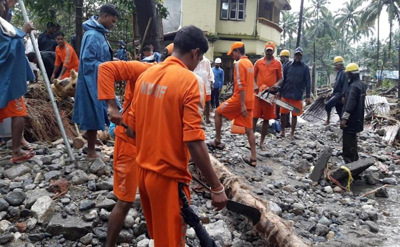 As rains caused flooding and landslides, rescue authorities such as the National Disaster Response Force (NDRF) arrived to provide aid in affected areas. Source/Naveen Nair