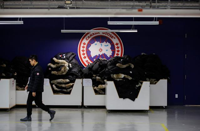 A man walks by jackets at the Canada Goose factory in Toronto, Ontario, Canada, February 23, 2018. REUTERS/Mark Blinch