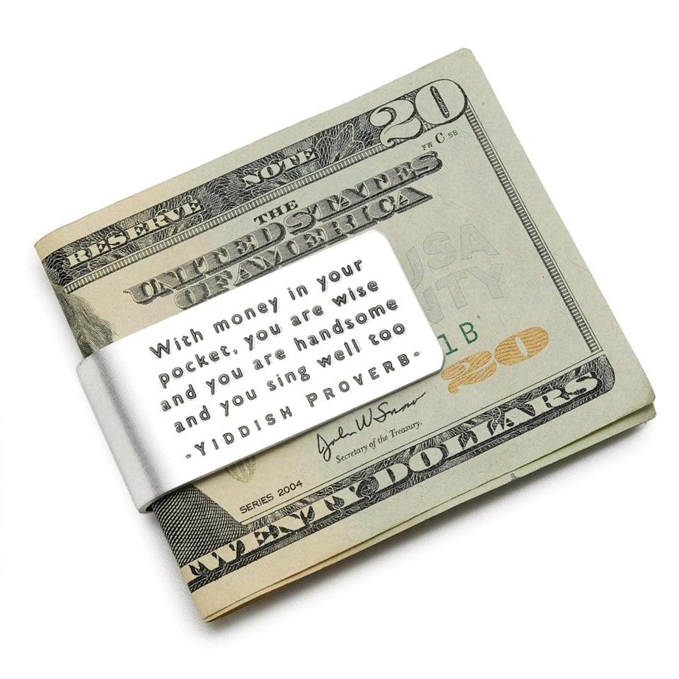 "<p>Get a chuckle or two with this <span>Yiddish Proverb Money Clip</span> ($8). It says, ""With money in your pocket, you are wise and you are handsome and you sing well too."" </p>"