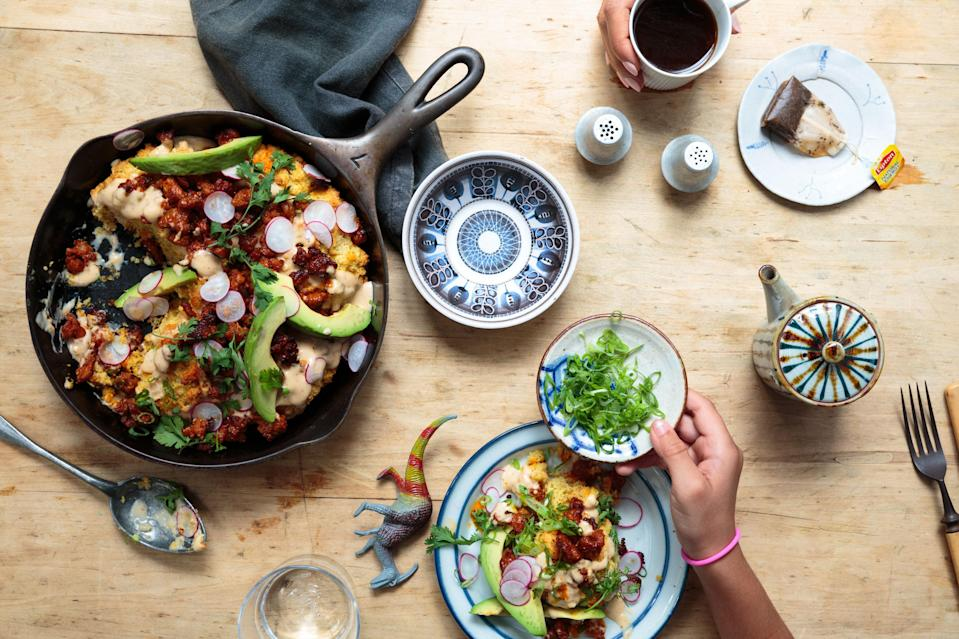 """Biscuits and gravy meet loaded nachos. <a href=""""https://www.bonappetit.com/recipe/cornmeal-biscuits-with-chorizo-gravy-and-scallions?mbid=synd_yahoo_rss"""" rel=""""nofollow noopener"""" target=""""_blank"""" data-ylk=""""slk:See recipe."""" class=""""link rapid-noclick-resp"""">See recipe.</a>"""