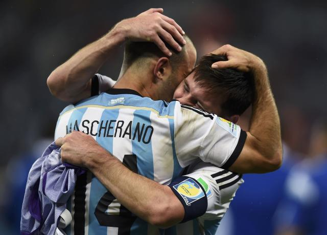 Argentina's Javier Mascherano hugs teammate Lionel Messi (back) after their team's victory over the Netherlands at the end of their 2014 World Cup semi-finals at the Corinthians arena in Sao Paulo July 9, 2014. REUTERS/Dylan Martinez (BRAZIL - Tags: SOCCER SPORT WORLD CUP TPX IMAGES OF THE DAY) TOPCUP