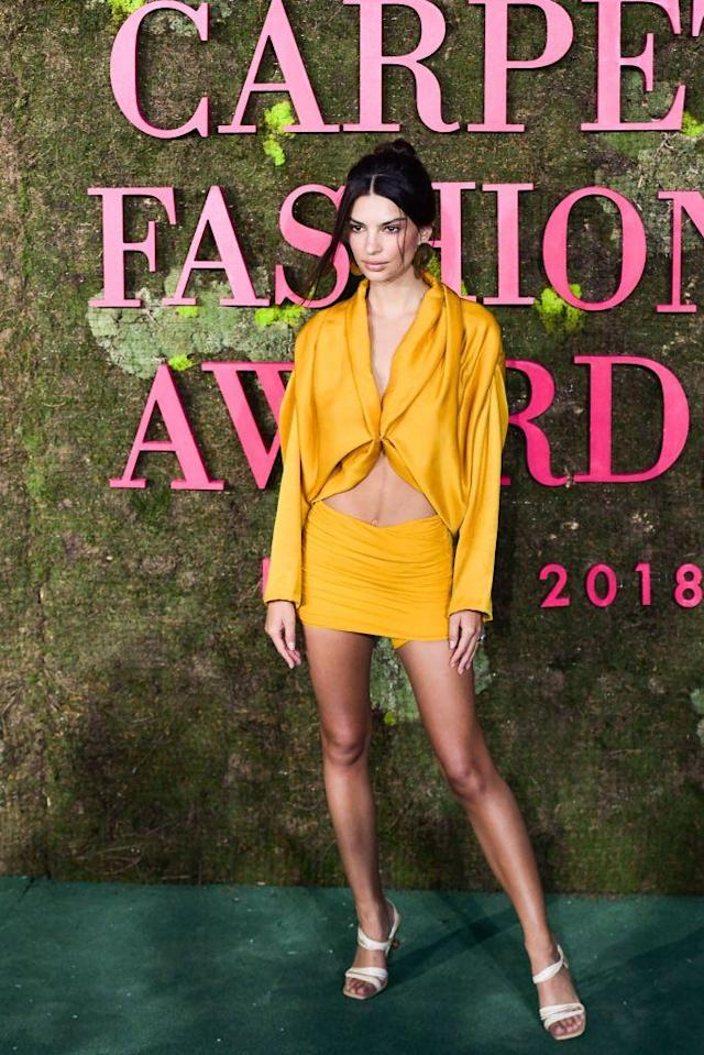 <p>On September 23, model Emily Ratajkowski attended the Green Carpet Fashion Awards 2018 in a cut-out yellow mini co-ord. <em>[Photo: Getty]</em> </p>
