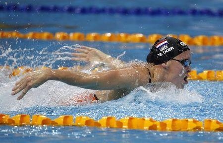 Inge Dekker of the Netherlands swims to win the women's 100m butterfly event of the FINA Swimming World Cup in Singapore November 1, 2014. REUTERS/Edgar Su/Files