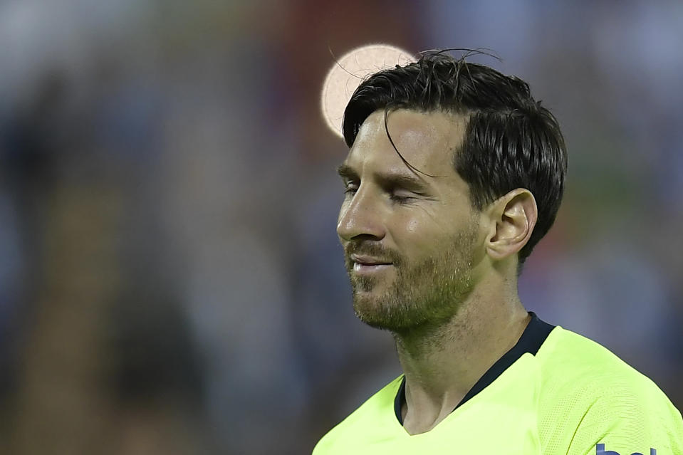 Barcelona's Lionel Messi grimaces during Wednesday's loss to Leganes. Barca and rival Real Madrid lost on the same day for the first time since early 2015.