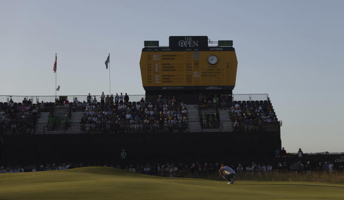 South Africa's Louis Oosthuizen lines up his putt on the 18th green during the third round of the British Open Golf Championship at Royal St George's golf course Sandwich, England, Saturday, July 17, 2021. (AP Photo/Peter Morrison)