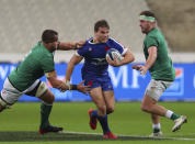 France's Antoine Dupont, centre is tackled by Ireland's CJ Stander, left, during the Six Nations rugby union international match between France and Ireland in Paris, France, Saturday, Oct. 31, 2020. (AP Photo/Thibault Camus)