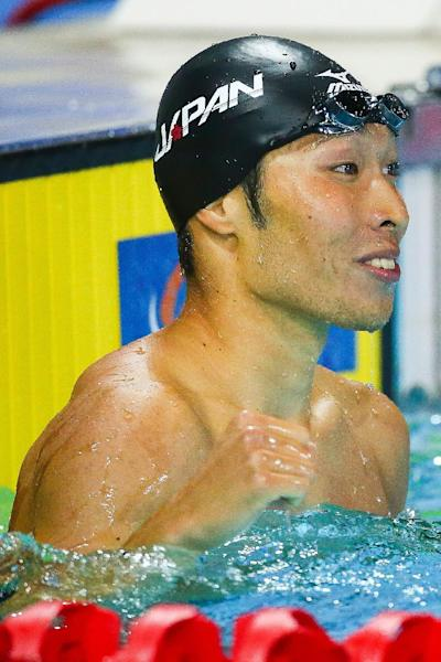Japan's Kosuke Hagino celebrates after competing in the 200m individual medley final at the Pan Pacific Swimming Championships in Gold Coast on August 24, 2014 (AFP Photo/Patrick Hamilton)