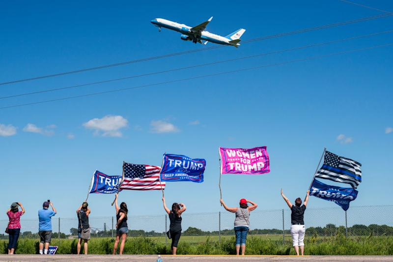 Supporters wave as Air Force One takes off after a rally in Mankato, Minnesota. Source: Getty