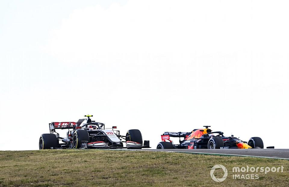 """Kevin Magnussen, Haas VF-20, Max Verstappen, Red Bull Racing RB16<span class=""""copyright"""">Mark Sutton / Motorsport Images</span>"""