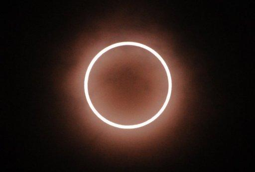 "An annular solar eclipse seen from Tokyo, Japan, on May 21. Millions turned their eyes to the sky on both sides of the Pacific as a solar eclipse created a ""ring of fire"" from Asia to the western United States"