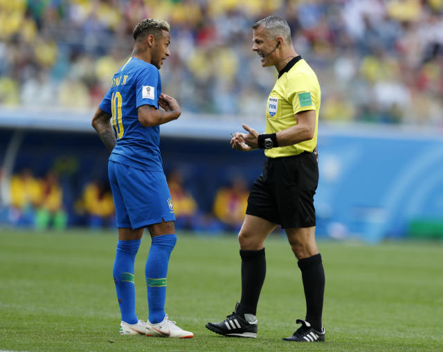 Brazil's Neymar, left, reacts as he talks with referee Bjorn Kuipers from Netherlands during the group E match between Brazil and Costa Rica at the 2018 soccer World Cup in the St. Petersburg Stadium in St. Petersburg, Russia, Friday, June 22, 2018. (AP Photo/Alastair Grant)