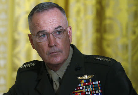 FILE PHOTO - U.S. Joint Chiefs Chairman General Joseph Dunford  attends a meeting of the National Space Council in the East Room of the White House in Washington, U.S., June 18, 2018. REUTERS/Leah Millis