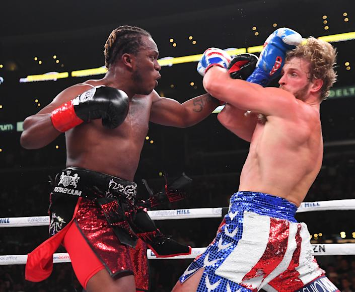 Logan Paul (R) and KSI (L) exchange punches during their pro debut fight at Staples Center on Nov. 9, 2019 in Los Angeles. KSI won by decision. (Photo by Jayne Kamin-Oncea/Getty Images)