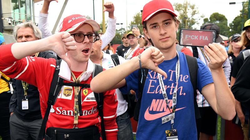 Formula One fans, pictured here looking furious after the Australian Grand Prix was cancelled.