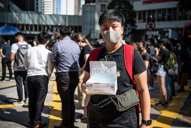 PHOTO: A woman offers masks during a protest against a government ban on face masks, Oct. 4, 2019 in Hong Kong, China. (Laurel Chor/Getty Images)
