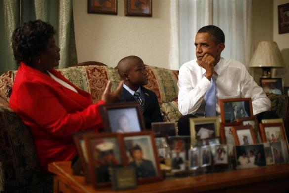 President Obama listens to Maude Smith and her grandson David Robichaux Jr. in their home in the Columbia Parc Development in New Orleans, Louisiana, August 29, 2010.